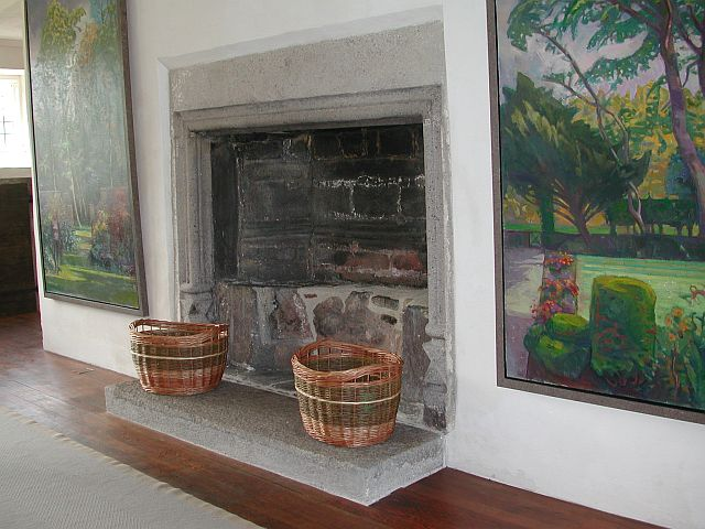 Two of Graham's log baskets beside the fireplace